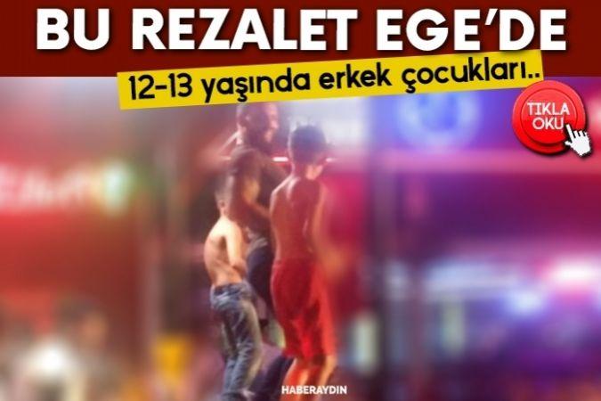 Fethiye'deki bir barda erkek çocuklarını masanın üstüne çıkartıp dans ettirdiler