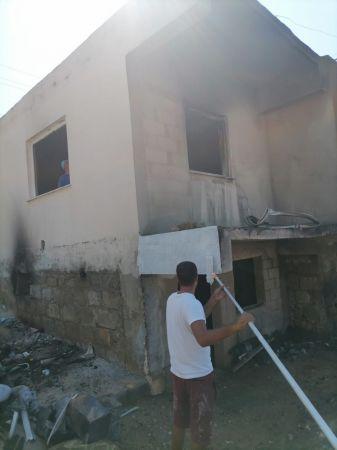 Aydıncık yangınında zarar gören evler tamir ediliyor