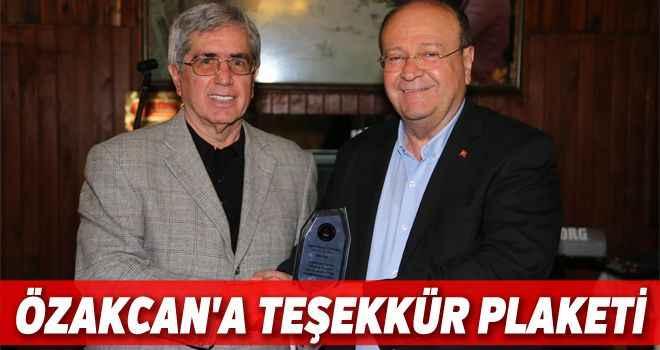 Özakcan'a teşekkür plaketi