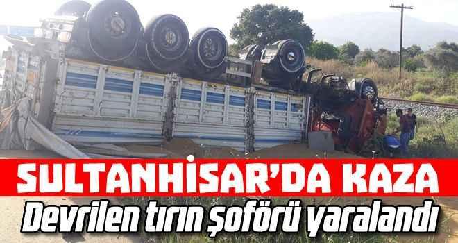 Sultanhisar'da devrilen tırın şoförü yaralandı