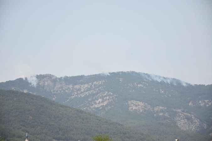 Karacasu'da farklı bir noktadan daha dumanlar yükselmeye başladı