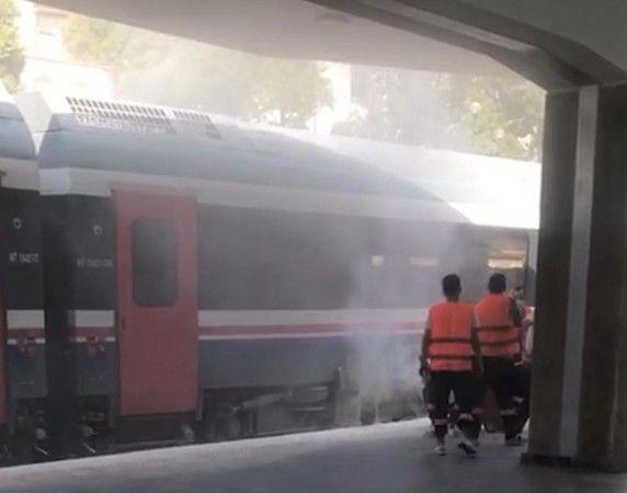 Aydın'da, istasyona yanaşan yolcu treninden çıkan alevler paniğe neden oldu.