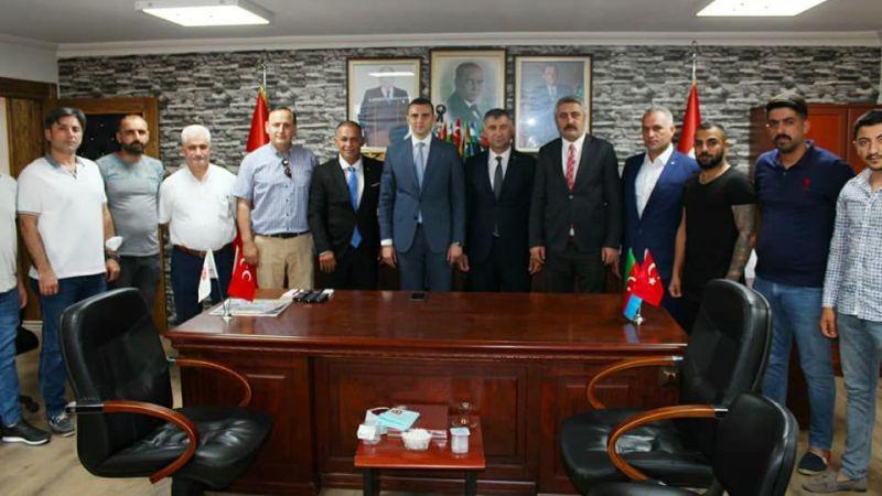 KAIV'dan MHP'li yeni başkana tebrik ziyareti