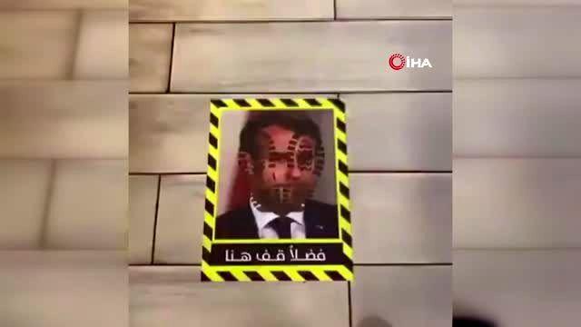Restoranın zeminine Macron'un resmini yapıştırdılar