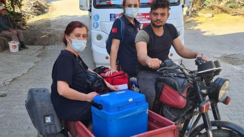 Nazilli'de sağlık çalışanları aşı yapmaya motosikletle gitti