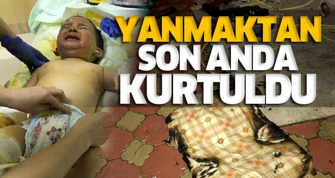 Odasında yangın çıkan çocuğu annesi kurtardı