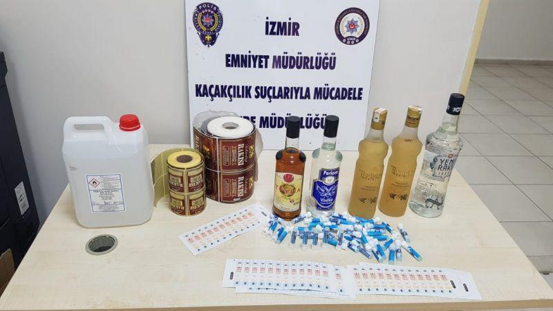 İzmir'de 921 şişe sahte içki, 600 litre etil alkol ele geçirildi