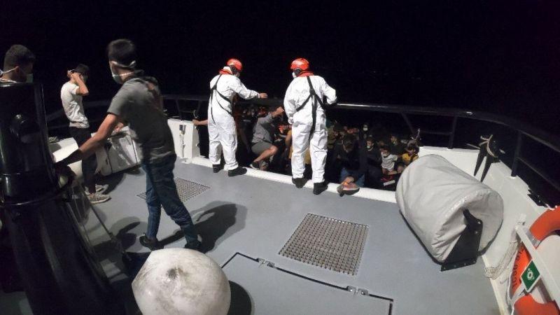 Aydın'da Türk kara sularına geri itilen 83 düzensiz göçmen kurtarıldı