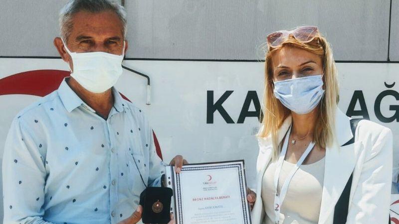 Gazeteci Karataş'a can kurtarma madalyası