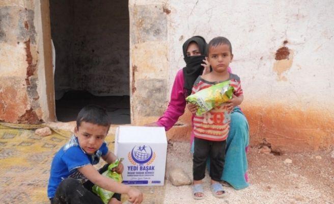 Suriye'deki yetimlere yardım