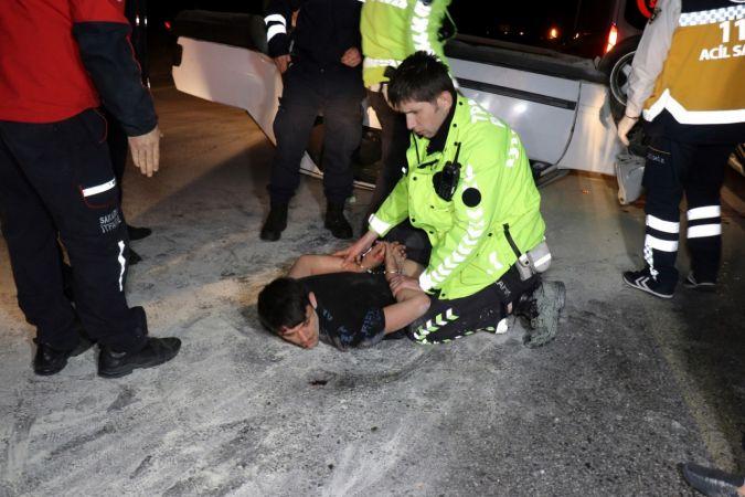 Alkollü sürücü kendini kurtaranlara saldırdı