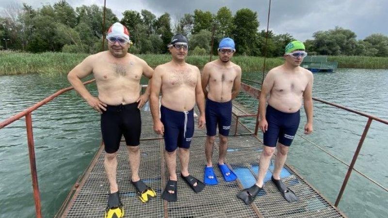 100'ncü yıl anısına gölü yüzerek geçtiler