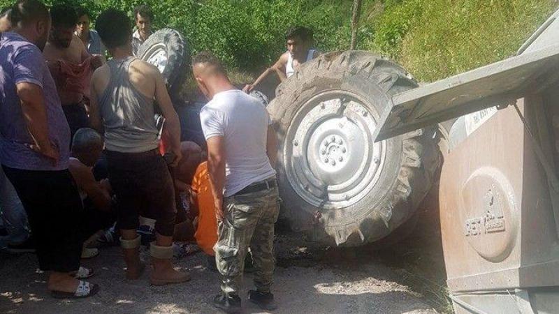 Uçurumdan kurtulurken trakörün altında kaldı