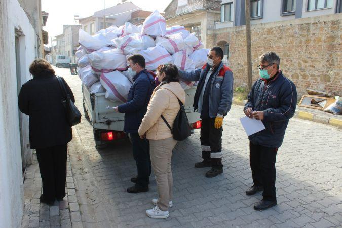 Burhaniye yakacak yardımları devam ediyor