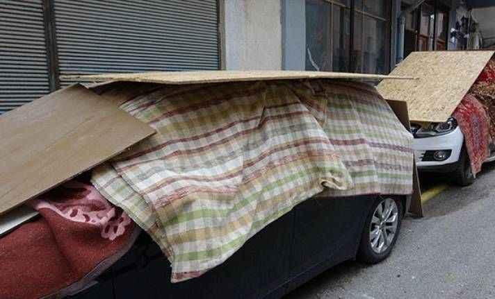 Araçları doludan korumak için tahtalı önlem
