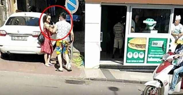 Tartıştığı erkek arkadaşına sokak ortasında kafa attı