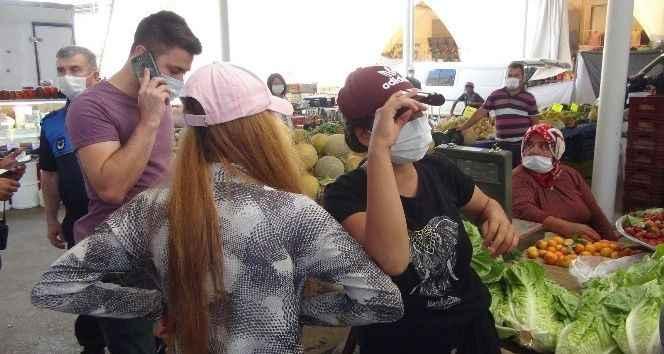 Manavgat'ta 2 kız pazarda 'tırnakçılık' yaparken yakalandı