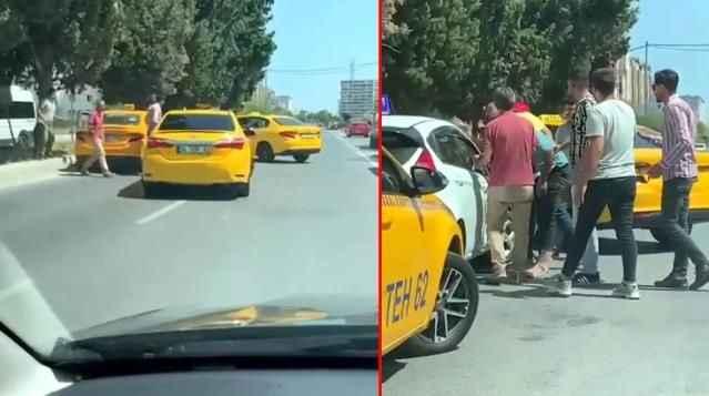 Yine taksici dehşeti! Tartıştıkları sürücü adayının yolunu kesip aracını yumrukladılar