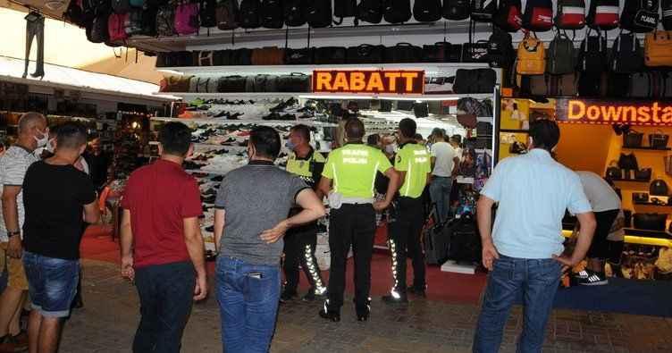 Alanya'da taklit ürün kavgası!  Avukatı linçten polis kurtardı