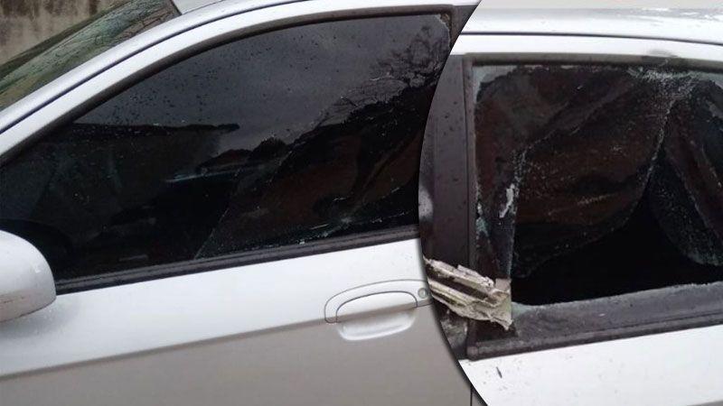 Arabasının camlarını kırdılar