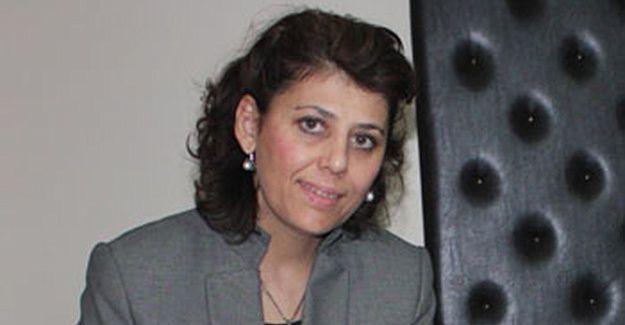 AKP'li Olşen, ev gezmesinde