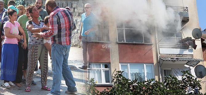 Evde yangını çıkardığı iddiasıyla oğlunu dövmeye kalktı