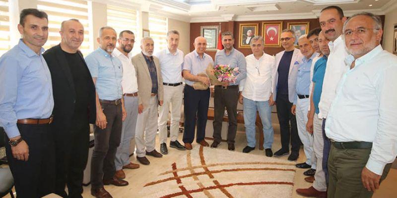 Eski ilçe başkanları Turan'a gitti