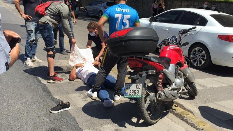 Kaza sonucu yaralanan sürücüyü güneşten böyle korudular