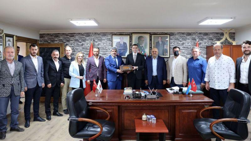 KOTO'dan MHP İl Başkanı Kurt'a 'hayırlı olsun' ziyareti