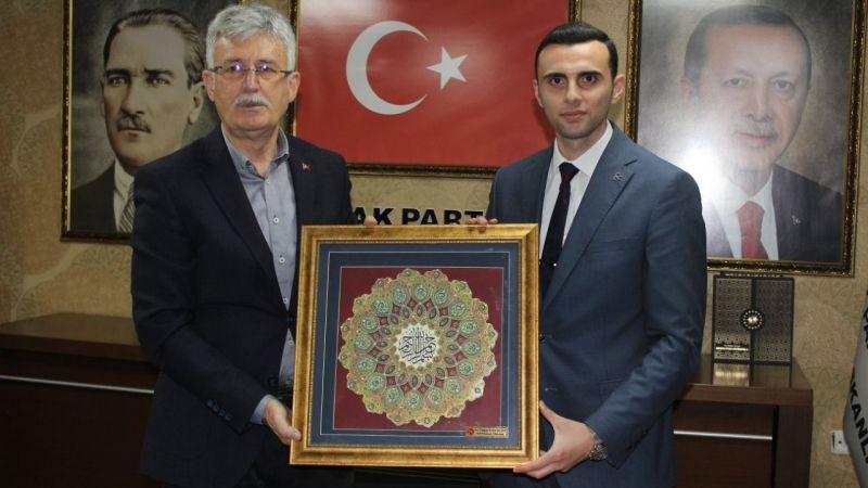 MHP'den AK Parti'ye iadeyi ziyaret