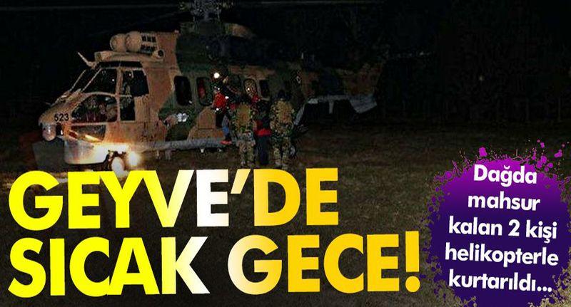 Geyve'de sıcak gece! Dağda mahsur kalan 2 kişi helikopterle kurtarıldı...