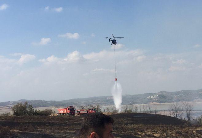 Kundaklanan ağaçlık alana 3 helikopter birden müdahale etti