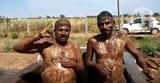 Hindistan halkı virüsten korunmak için ineğin idrar ve dışkısıyla yıkandı