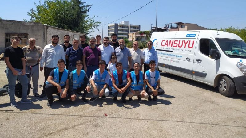 Cansuyu Kozan'da yaraları sarıyor