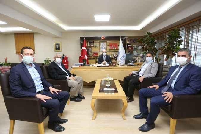 Aygün mevkidaşı Turan'a  Aspir Yağı takdim etti