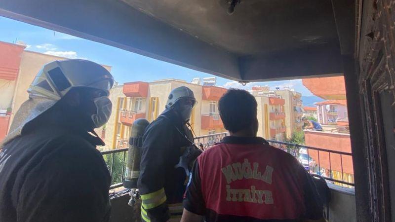 Patlayan çakmak evde yangın çıkardı