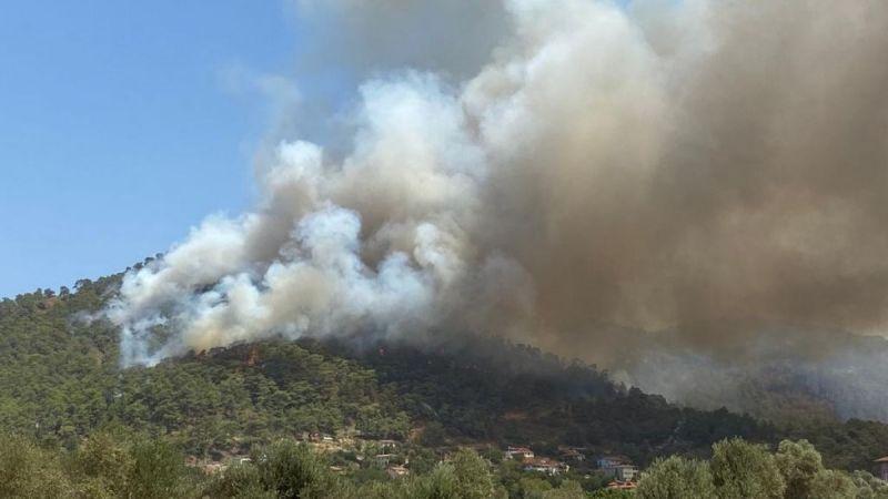 Marmaris yangını tekrar parladı, alevler yerleşim yerlerine ulaştı