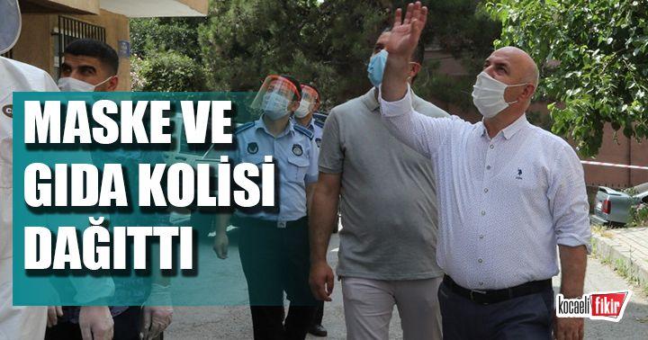 Başkan Bıyık, karantina altındaki sokağı ziyaret ederek maske dağıttı