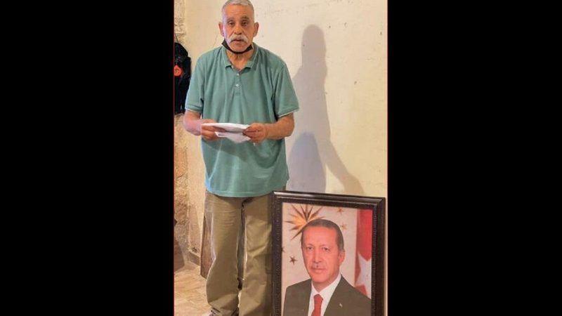 Dükkanına  Erdoğan fotoğrafı asan adama ceza