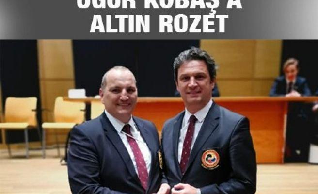 UĞUR KOBAŞ'A ALTIN ROZET