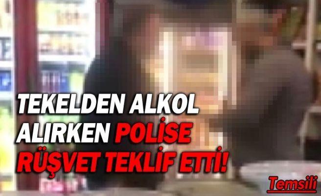 Tekelden alkol alırken polise rüşvet teklif etti!