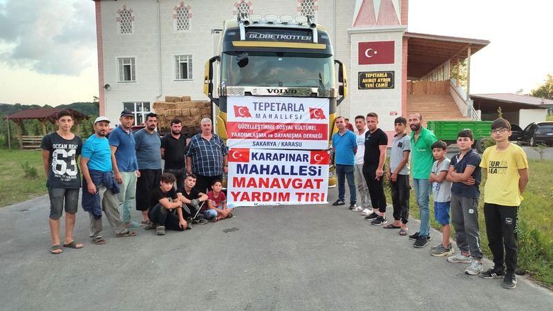 Karasu'da iki mahalleden yangın mağdurlarına yardım