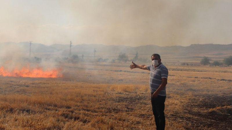 Buğday tarlasındaki yangın çiftçilerin müdahalesiyle söndürüldü