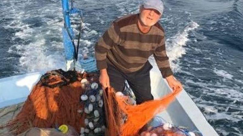 Ağlarını temizleyen balıkçı Necmi teknesinde son nefesini verdi
